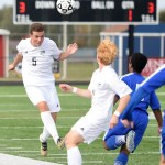 Junior Max Maday heads the ball to a player up the field at the beginning of the first half. Photo by Morgan Browning