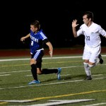 Junior Cooper McCullough follows his opponent, trying to get the ball. Photo by Maddie Smiley