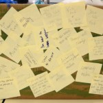 A Wyandotte group's project incorporates sticky notes that they passed around the room, asking other students to write positive and negative things in their lives. Photo by Sophie Storbeck