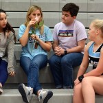 Seniors Chloe Azorsky, Emma Stanford, and Matthew Kaplan talk to Senior Caroline Kessinger before she goes on to cheer. Photo by Ellie Thoma