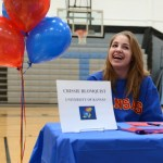 Senior Crissie Blomquist laughs with a friend before the ceremony. She signed today to commit to swim at the University of Kansas. Photo by Ellie Thoma
