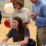 Senior Emma Henderson laughs as she finishes signing. Photo by Ellie Thoma