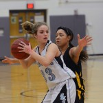 Freshman Annie Gorman keeps possession of the ball from an opposing player from Shawnee Mission West.