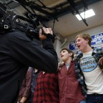 The SME student section is filmed by a news camera singing the school song after the JV game ends. In the JV game, Rockhurst beat the Lancers 57-44. Photo by Diana Percy