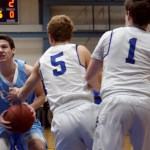 Senior Connor Rieg focuses on getting around Rockhurst defense to make a shot. Photo by Diana Percy