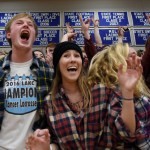 Seniors Tripp Mohr and Jessica Parker, along with the rest of the student section, celebrate after the Lancers make a shot. Photo by Diana Percy