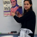 Sophomore Lucy Hoffman explains her poster to the class. Photo by Audrey Kesler