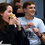 Sophomore Lucy Hoffman and Tom Joyce laugh and snack on treats brought by students. Photo by Audrey Kesler