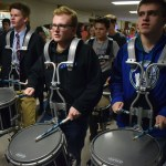 Seniors Ian Longan, Deegan Poores, and Xan Denniston perform a drumline number in the hall at the end of the pep assembly. Photo by Audrey Kesler