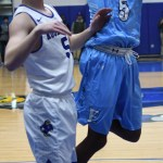 Junior Kelyn Bolton shoots the ball past the Rockhurst player. Photo by Carson Holtgraves