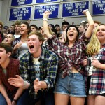 The student section goes wild as Rockhurst basketball player Scotty Thompson is announced during the line-up. Photo by Ellie Thoma