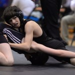 Freshman Charlie Voyset attempts to keep his opponent pinned to the ground. Photo by Celia Hack