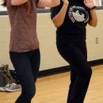 Sophomore Anika Radadiya explains a dance move to a confused club member. Photo by Ellen Swanson