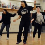 Sophomores Anika Radadiya and Aakriti Chaturvedi lead the club in practicing the dance they learned. Photo by Ellen Swanson