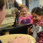 Senior Lars Troutwine begins to calm down the bird after he gives it to a kindergartener. Photo by Ty Browning