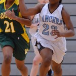 Sophomore Yasmeen Byers runs the ball down the court to make a basket. Photo by Reilly Moreland
