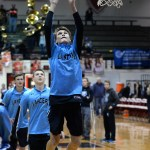 Junior Andy Maddox jumps up for the rebound during the team's warmup drill. Photo by Kaitlyn Stratman
