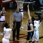 Junior Seamus Carroll goes up with his opponent, and makes the shot. Photo by Kaitlyn Stratman