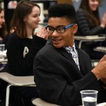 Sophomore Amiel Green claps after sophomore Liberty Bennion raps about Napoleon. Photo by Morgan Browning