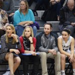 Coaches Lawrence, Delaney, and Taylor and sophomore Jordan Yowell and junior Katie Hise reacting to a play on the court. Photo by CJ Manne