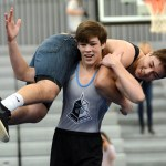 Junior Andrew Schmidt carries senior Fabrizzio over his shoulders. Photo by Ellie Thoma