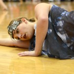 Junior Tinka McCray lays on the ground at the end of the dance. Photo by Ellie Thoma