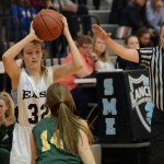 Freshman Kathleen Stanley looks for a teammate to pass the ball to, in order to shoot a basket. Photo by Katherine Odell