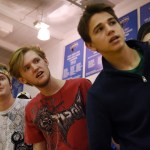 Seniors Brayten Bowers, Jack Griswold and Oliver Bihuniak look around the crowd to see if their classmate, senior varsity basketball player Kyle Haverty, is okay after getting injured in the girls' basketball game. Photo by Diana Percy