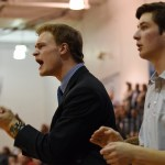 Senior basketball managers Lane Johnston and Chace Prothe yell at the referees and the other teamin reaction to a play near the end of the game. Photo by Diana Percy