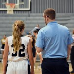 Coach Taylor talks with freshmen Kathleen Stanley on the sideline. Photo by Laini Reynolds