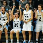 The Girls Varsity team cheers on the bench after senior Kyle Haverty makes a three pointer. Photo by Audrey Kesler