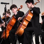 """Freshmen Jackson Weaver and Vincent Hsiung play the cello in the Philharmonic and Freshman Orchestra. The orchestras performed """"Bylina"""" by Michael Reilly and Arr. Illya Levinson and """"It Takes Two"""" by Chris M. Bernotas. Photo by Haley Bell"""