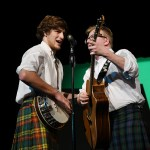 """Seniors Isaac Schmidt and Deegan Poores sing """"Whisky in the Jar"""" as part of their performance with Irish folk band the Heartlands Rovers. Photo by Haley Bell"""