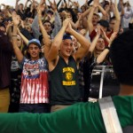 Junior Sid Choudhury boots the energy in the student section by playing his drum during the chants. Photo by Ellie Thoma