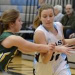 Freshman Kathleen Stanley dribbles towards the goal, trying to avoid her defender. Photo by Ellen Swanson