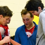 Seniors John Arnspiger, Eli McDonald, and Logan Cleaver check out the statistics from the game.  With two more players than the Sea Turtles, their team won 44-37. Photo by Annie Lomshek