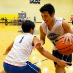 Senior Joseph Lemos warms up for the game by playing senior Ryan Stubbers in one-on-one. Photo by Annie Lomshek