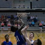 Senior guard, Connor Rieg, watches as his shot goes in. Photo by Kaitlyn Stratman