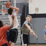 Junior Tate Hassenflu watches junior Peyton Wiklund try to steal the ball from the other team. Photo by Morgan Plunkett