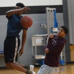 Freshman Tajee Jones watches his team mate make a basket, during his team games class. Photo by Morgan Plunkett