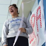 Senior Aurora Nelson sets up the ribbon around the wpa sign in the cafeteria. Photo by Morgan Plunkett