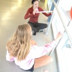 Sophomores Olivia Capponechi and Hannah Phillips decorate the ramp with streamers. Photo by Maddie Smiley