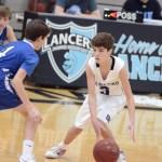 Freshman Luke Hanson dribbles around the player. Photo by CJ Manne