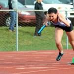 Junior Katie MacAdam pushes off from her starting block in her 400 meter relay. Photo by Luke Hoffman