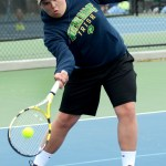 Junior Jacob Roberts returns the ball during the second set of their match. Photo by Luke Hoffman
