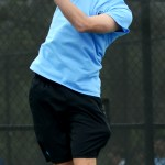 Freshman Jack Slaughter serves the ball to his opponent in the second set of his match. Photo by Luke Hoffman