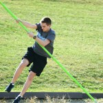 Freshman Matt Rothe completes his practice jump as a pole vaulter on the track team. Photo by Luke Hoffman