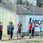 The new pole vaulters on the track team wait for their turn to practice. Photo by Luke Hoffman