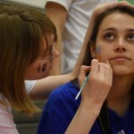 Junior Olivia Howgill gets her face painted by an art student. Photo by Diana Percy