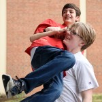 Sophomore Becker Truster carries sophomore Jared Ho back into the auxiliary gym where the Cabaret was held. Photo by Diana Percy